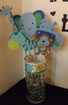Hey, I found this really awesome Etsy listing at http://www.etsy.com/listing/152077664/girl-or-boy-jungle-themed-centerpieces
