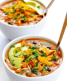 "Cheesy Enchilada Soup This thick, cheesy soup loaded with tomatoes, beans, chicken and green chiles will be your answer to ""What's for dinner?"" on rainy days, thanks to Gimme Some Oven. Top with tortilla chips, sliced avocado, sour cream and cilantro once it's piping hot in 20 minutes."