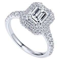 This stunning 18kt white gold double halo engagement ring made for an emerald cut center diamond is one of the prettiest rings I've seen! It' so gorgeous!