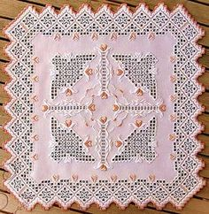 """Minerva brings us a delicate doily featuring pale pink threads for a dainty touch.  The stitch count is 264 x 264 and the design size is 18.5"""" x 18.5"""" on 28-count Lugana."""