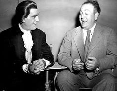 "Boris Karloff and Val Lewton between takes on ""Bedlam""."