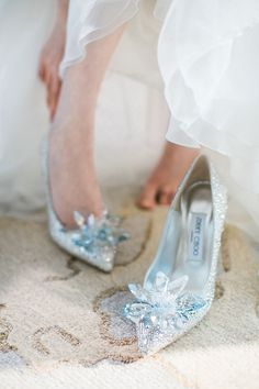 These Jimmy Choo bespoke Cinderella bridal shoes {Facebook and Instagram: The Wedding Scoop}