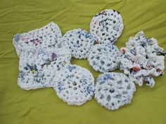 Plastic Bag Pot Scrubbers: Crochet plastic bags into little shapes. You can use these to scrub dishes, pots, and other cookware.   Source: Etsy user ReWorkedDesigns