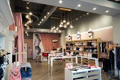 Lingerie store interior design in pink and gray combines decadent details with minimalist elements, and the result is a beautifully feminine space. Fake Beam, Lingerie Store Design, Boutique Interior Design, Interior Design Studio, Furniture Placement, Shelf Design, Modern Interior, Modern Design, Mindful