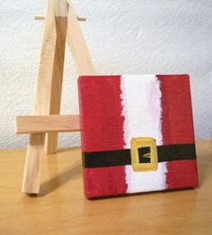 so easy! Have kids each paint a Santa section on individual canvas and hang the outcome together ! Next year!