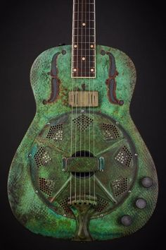 James Trussart Guitars The woman in green. SteelReso Titanic Green Snakeskin Engraved. Arcane Inc. Pickup and Piezo. Parallel Series Push Pull Switch for the Humbucker.