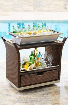 Our elegant, all-weather Ultimate Serving Cart makes entertaining outdoors easier. The handsomely woven cart preps and stores all the essentials for cocktail hour or afternoon brunch.
