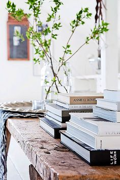 ... ♥ ... Stack of books on a beautiful wood table and  a simple flower arrangement - great feng shui! More tips: http://FengShui.About.com