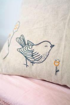 Ishtar Olivera - bird embroidered on a linen cushion