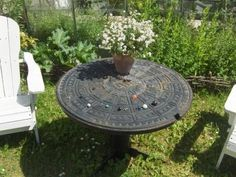 This garden table was once a manhole cover.