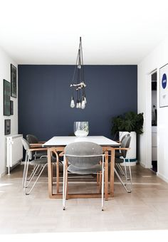 Blue and green walls, a purple kitchen floor and lots of green plants, including a verdant wall, are some of the features you'll find in th. Dining Room Blue, Dining Table, Table Lamp, Rooms Ideas, Purple Kitchen, Blue Furniture, Blue Home Decor, House Wall, Kitchen Flooring