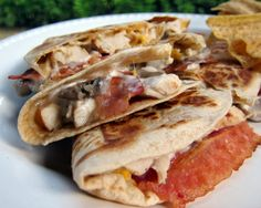 Chicken Bacon Ranch Quesadilla    1 large tortilla  2 slices cooked bacon  1-2 oz chopped chicken (I used Perdue chicken strips)  1 Tbsp chopped mushrooms  1-2 tsp Ranch dressing  1/3 cup shredded cheddar cheese  cooking spray