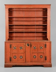 Dresser, Montgomery or Randolph County, 1820-1850, yellow pine throughout, single-case construction, paneled doors opening to a shelved interior, doors with fylfot and compass star white-painted decoration on black circular ground centering a crescent moon and star motif, case decorated overall in salmon-colored paint, 78-1/2 x 61-1/2 x 21-1/2 in.,