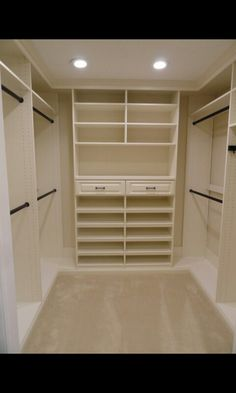 On each end of the master closet, but with drawers on the bottom half and doors on the top half to conceal the open shelving clutter :)