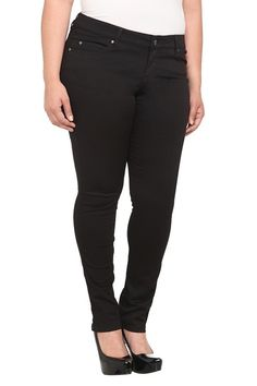 """This versatile twill skinny from Tripp balances edgy and feminine: skull rivets, """"T"""" on the back pockets and criss cross back belt loops. Pair casual with a tee or dressy with a blazer."""