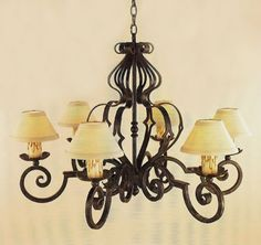 """R146-36  SIX LIGHT FORGED IRON CHANDELIER SHADE: 3 X 7 X 4 SHOWN WITH OPTIONAL ANTIQUE WAX CANDLES FINISH SHOWN: PUEBLO HT 24"""" W 36"""" MAXIMUM..."""