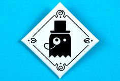 Mister Ghost's infamous badge balances formal and casual wear accessories.