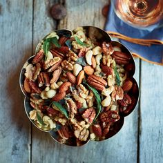 Cristina's Famous Nuts-Cristina Salas-Porras tosses assorted nuts with sage and rosemary and bakes them for a long time at a low temperature; they come out perfectly crisp. No wonder she's famous for them. | Food & Wine