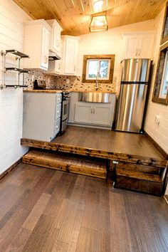 Next to the bed platform is a step up to the kitchen platform, which slides out to reveal an 8-foot storage compartment!
