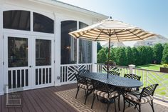 Two story double porch with outdoor fireplace, travertine patio, and AZEK deck - traditional - porch - nashville - by The Porch Company