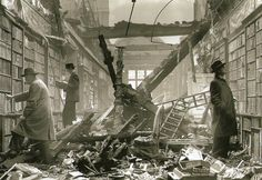 Readers browsing through the damaged library of Holland House in West London, wrecked by a bomb on 22 October 1940.