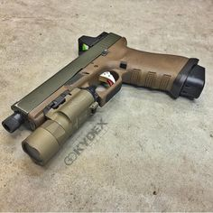 Custom Glock 17 9mm, featuring threaded barrel, reflex sight, light, ZEV trigger, extended mag floor plate, and sweet FDE frame