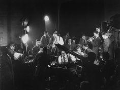 Duke Ellington, Dizzie Gillespie, Billie Holiday, Count Basie, Lester Young, Roy Eldreige, Cozy Cole, Gene Krupa among others.  What a reunion....  1943 Gjon Milli