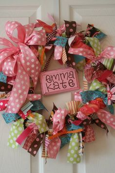 I would love to have one of these for Anyston's door to her room!...ribbon wreath..perfect for kids rooms or holidays