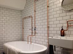 Love the exposed pipes, but prefer proper fittings rather than just open pipes.