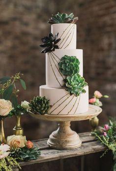 Three tier green and gold desert theme wedding cake; Featured Photographer: Paula O'Hara