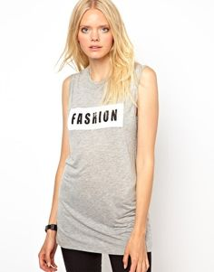 Just Female Fashion Gray Tank Vest. Or go for a simple and classy gray tank with nice shiny black leggings !!