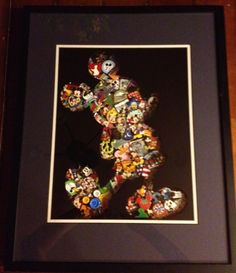 WDW pins collected in 2012, pins mounted on foam core board in shadow box, with vinyl cut Mickey Mouse sandwiched between glass