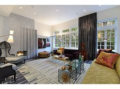 Elegant drawing room with fireplace and gorgeous treetop views. #interiordesign #NYC #townhouse