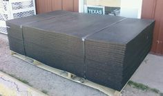 A stack of 4'x6' horse stall mats found at local feedstores