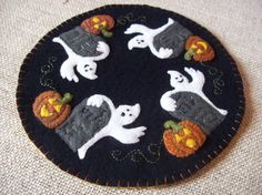 Ghosts in the Graveyard Halloween Candle Mat by rustiquecat