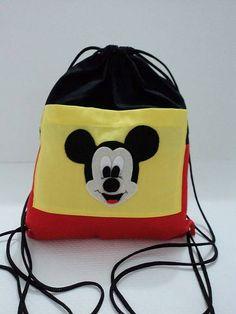 Mochila+em+tecido+100%+algodão+com+bolso+.+Mickeyconfeccionado+em+feltro+aplicados+no+bolso.+Quantidade+mínima+de+15+unidades. R$ 12,50