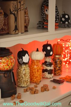 Mason jars, small painted pumpkins and candy are all you need via @The Goodwill Gal #goodwillhalloween