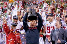 Stanford coach David Shaw, center, holds up the Pac-12 Championship trophy. Stanford defeated Arizona State, 38-14, in Tempe, Ariz. Pac-12 commissioner Larry Scott, right, looks on. (Ross D. Franklin/AP)