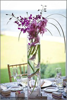 purple orchid and purple calla lily centerpiece