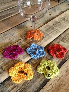 Ravelry: IdentiDaisies pattern by Maryanne Coates    Great idea!  These slip around the bottom of your wine glass to identify your drink.