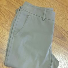 Vince. Trouser Pants Size 6. Hard to show true color but I consider it a taupe. Trouser style with two front pockets, two back pockets, front zip, hook and button closure. Fun optional cuff at ankle. Loops for belt. 15.5 inches approx flat across waist, inseam measures 28 inches approx. EUC, just returned from dry cleaners. Vince. Pants Trousers