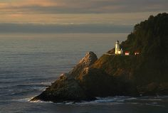 A Distant View Of The Heceta Head Photograph by Phil Schermeister