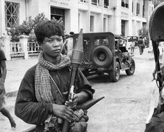 "April 12, 1975: The headline: ""Last Americans Leave Cambodia: Embassy Closed."" Several photographs circled a text: ""As the city of Phnom Penh fell: Early on April 17, five years of war in Cambodia ended as rebel troops entered a capital where white flags had suddenly appeared, some Government soldiers had unloaded their weapons, while some had changed to civilian clothes. The black pajama-like garb of Indochinese Communists had been donned by some of the Government office workers. At first"