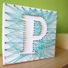 Do your own initial in a box with thread and nails. Just as easy as it looks!