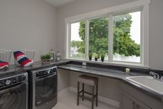 Laundry: ceramic tile floors, Formica counter tops, pained cabinets