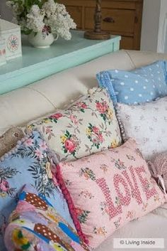 <3  Pretty pillows  I had a guest room and the bed was piled high with sweet pillows..was a great way to display my collection.  I just tossed another one on the pile and viola! it was art