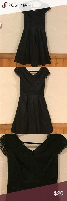 Chetta B black lace dress Perfect for a dance or more formal event.  This has Fitted top With the skirt of the dress slightly flaring out and has a built in tulle petticoat. Size 8 chetta B Dresses