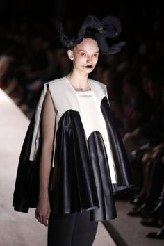 A model presents a creation for Comme des Garcons during the 2014 spring/summer ready-to-wear collection.