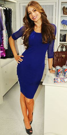 Sofia Vergara paired her cobalt sheath with topaz J/Hadley danglers and snakeskin Stuart Weitzman pumps in N.Y.C.