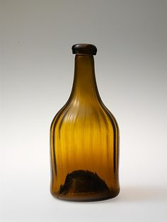 The Metropolitan Museum of Art - Bottle 1810–30 : Midwest, Ohio, United States; Mid-Atlantic, Pennsylvania, United States Culture: American : Blown, pattern-molded glass Dimensions: H. 8 1/2 in. (21.6 cm) : Glass